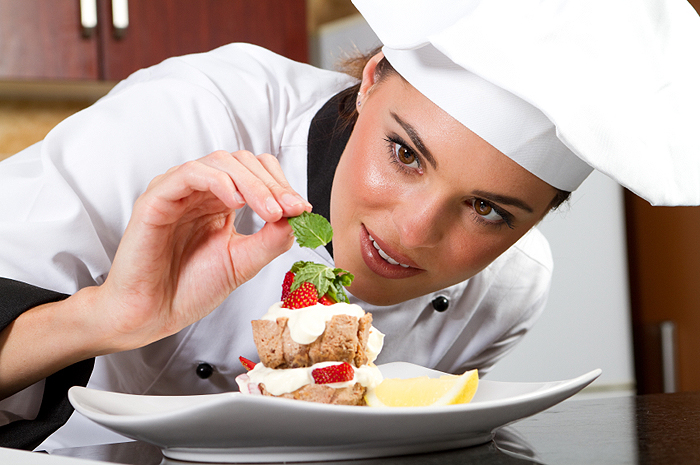 women decorating food